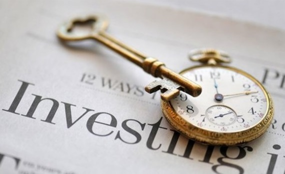 investing, watch and a key